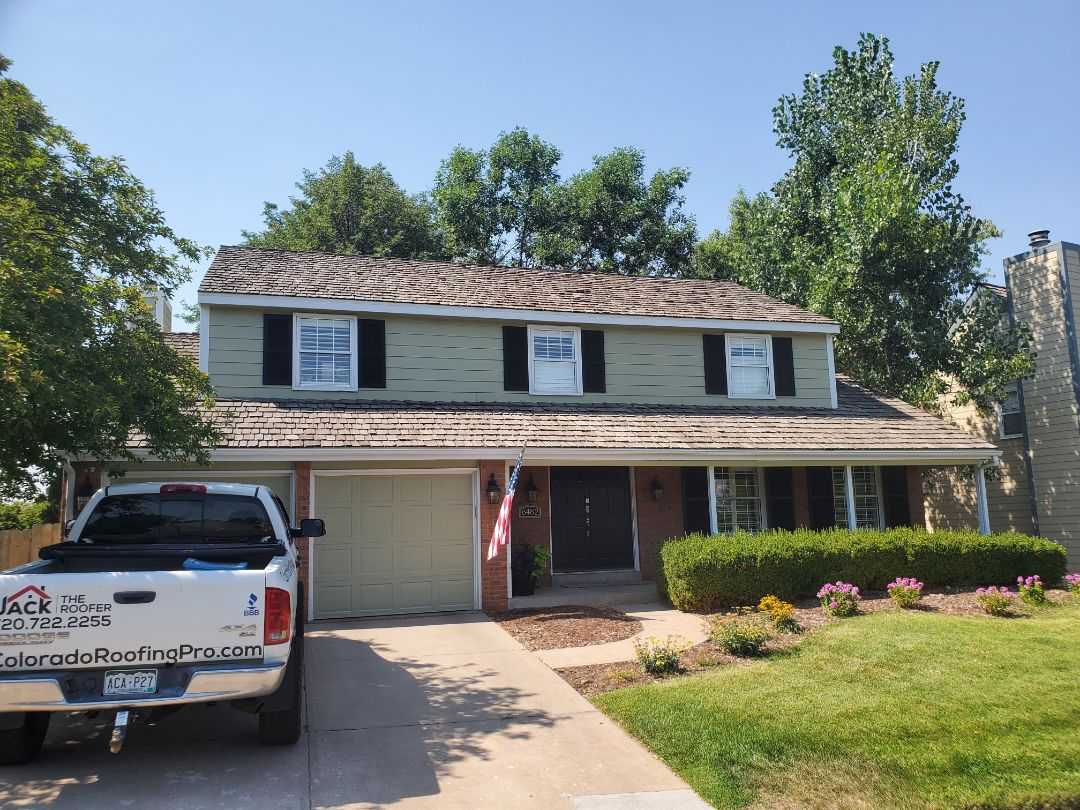 Centennial, CO - We are giving a roof estimate to replace this roof in Centennial Colorado. It currently has wood shake shingles and we will be replacing with a high quality asphalt shingle either class 4 impact-resistant or another high grade dimensional style roof