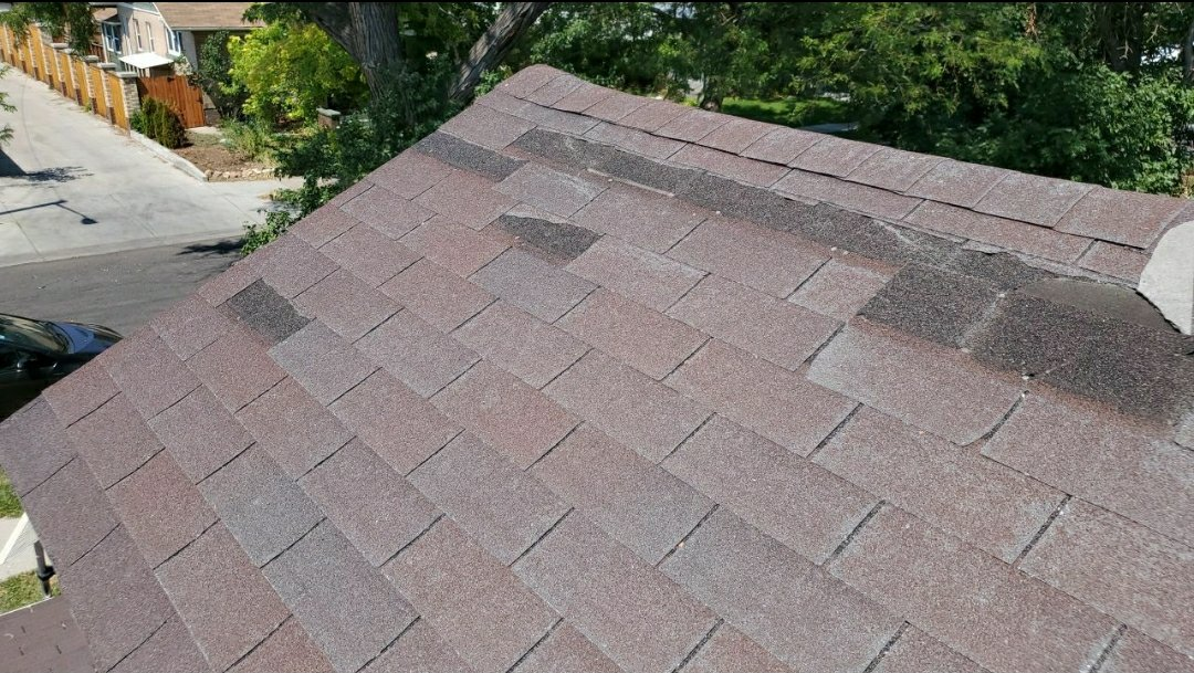 Denver, CO - We are doing a roof inspection and repair estimate for this house in Denver that has had shingles blow off in the recent wind storms.