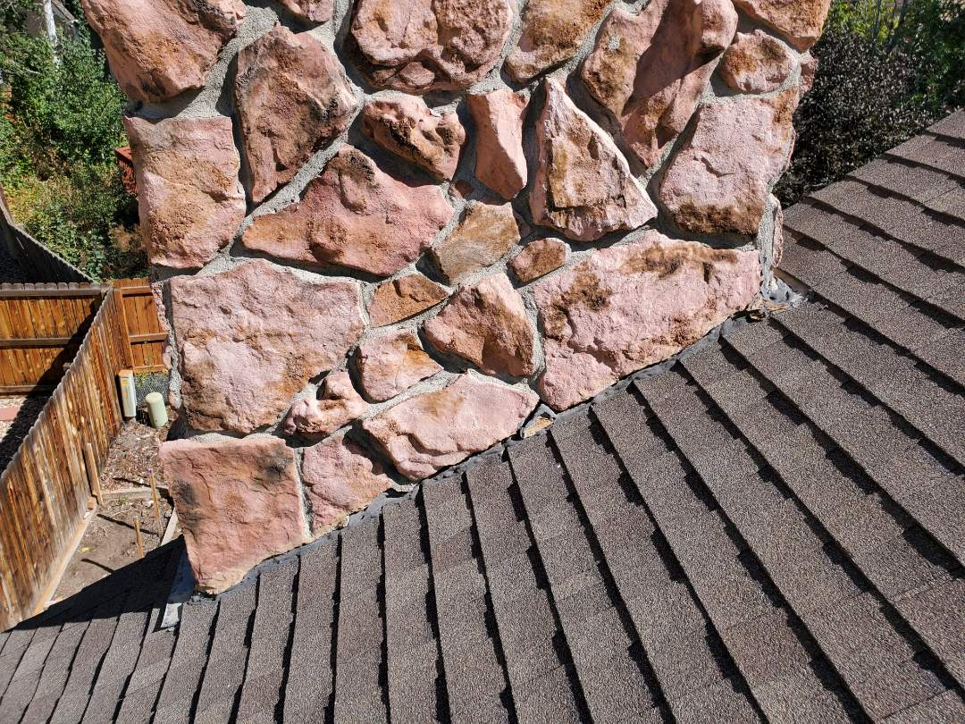 Parker, CO - We are doing a free roof inspection for this house in Parker that has a roof leak around this chimney. The chimney needs to be re-flashed to fix the roof leak