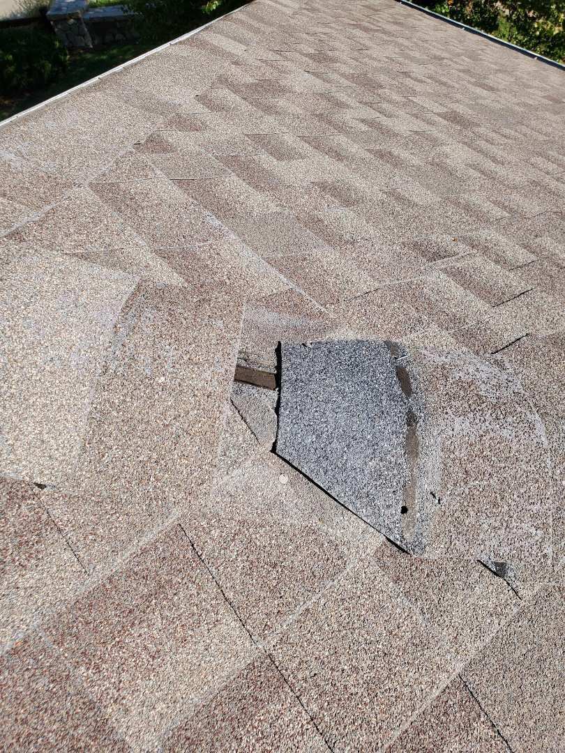 Parker, CO - We are doing a roof inspection for a roof leak that appears to be coming in around some flashing that needs to be replaced and some wind damaged shingles that have blown off