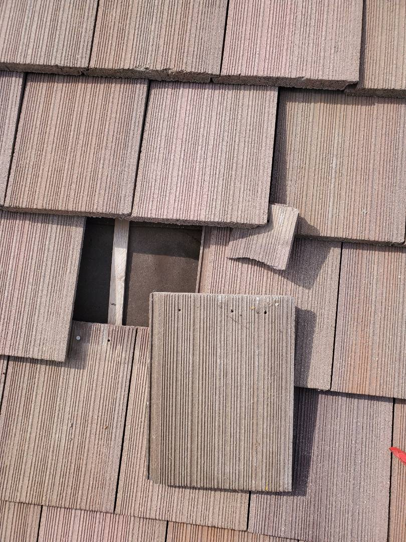 Parker, CO - We completed a concrete tile roof repair for this house that is being sold. We also reset and sealed a number of tiles around the roof