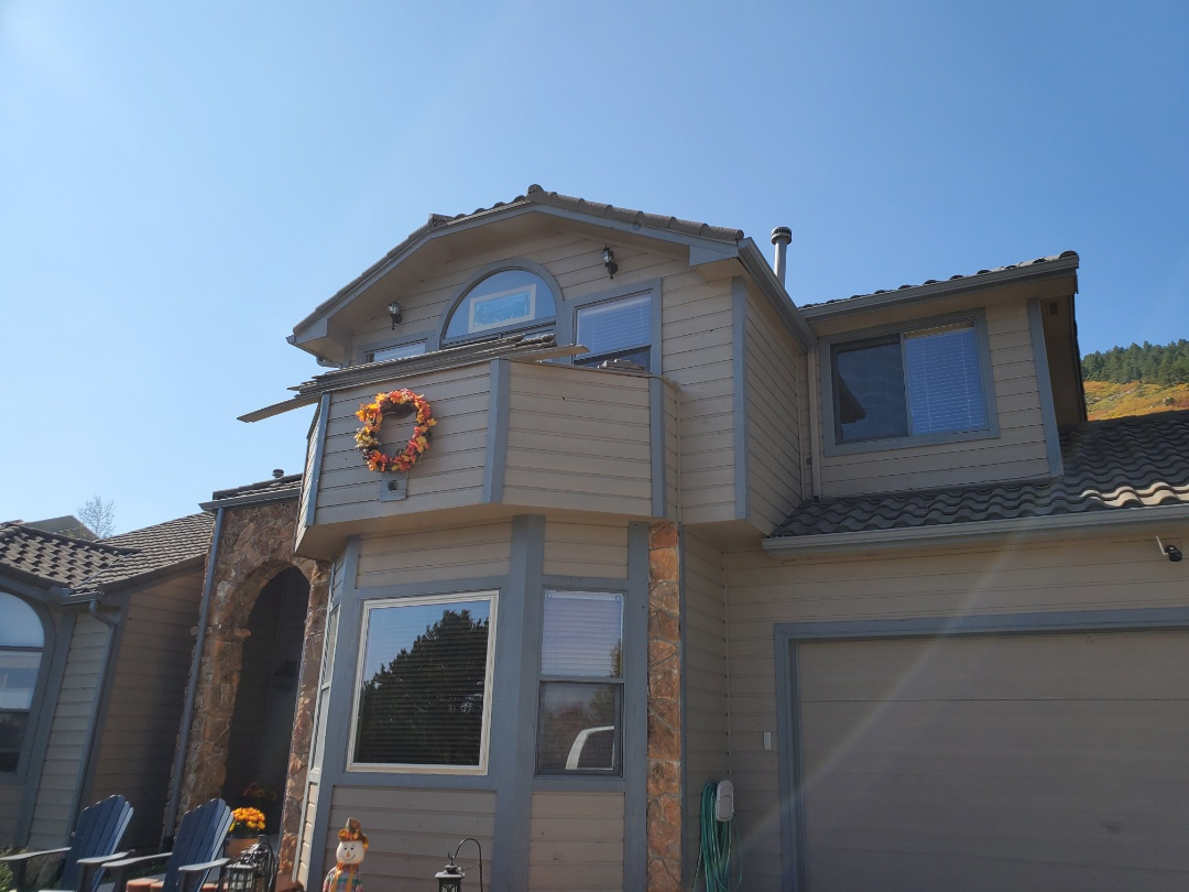 Littleton, CO - We are doing a re-roof for this flat roof underneath a deck on this house in roxborough, Littleton Colorado