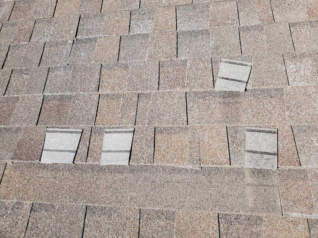 Parker, CO - We are looking at a roof in Parker that has wind damage and also has a problem that could be due to bad shingle product. We will be talking to the shingle manufacturer to determine if this falls under a claim