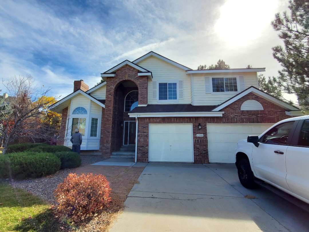 Littleton, CO - We are doing a roof inspection for this house in Highlands Ranch that has a roof leak and needs to have a new gutter installed