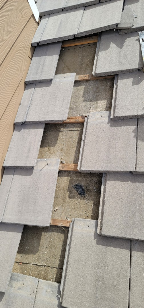Castle Rock, CO - We are doing a concrete tile roof repair for this house in Castle Rock that has roof damage and a roof leak