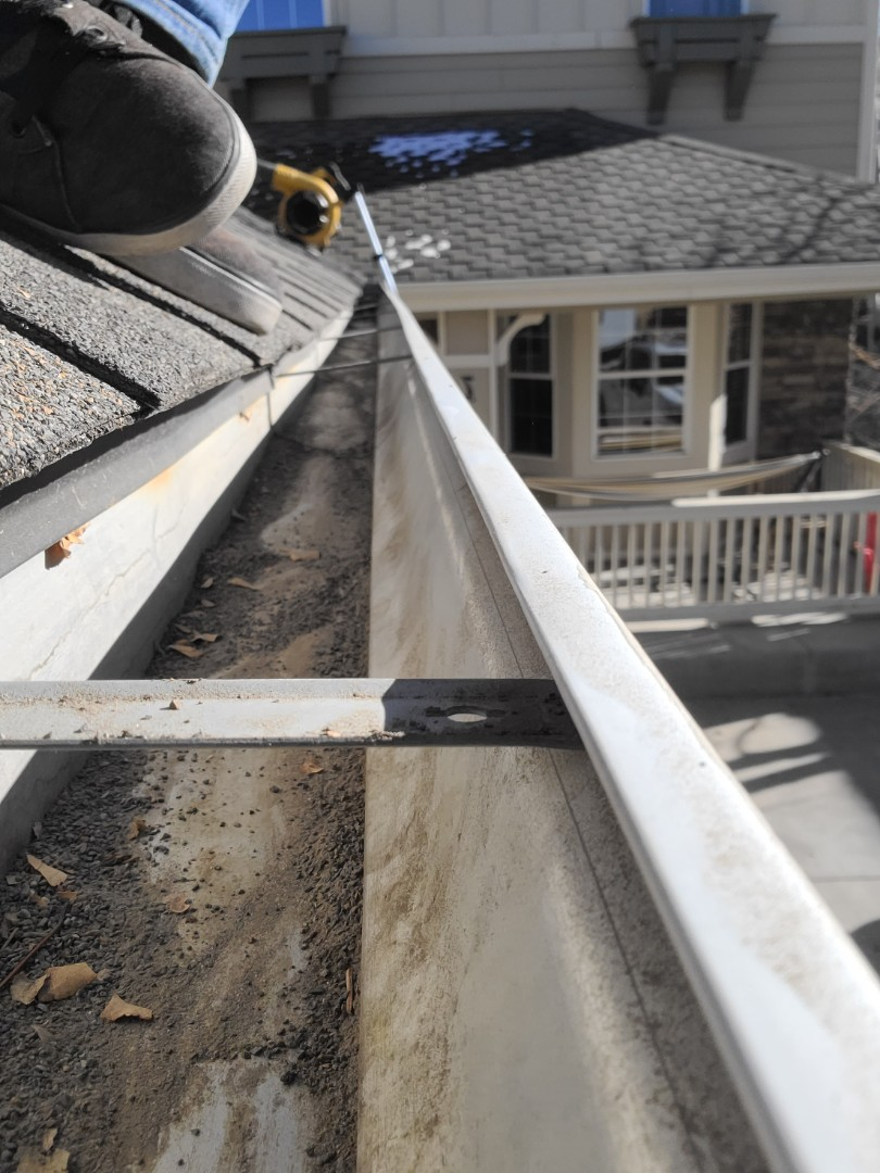 Aurora, CO - We are doing a gutter cleaning for this house in Aurora