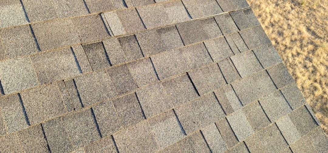 Parker, CO - We are doing a roof repair for this house in Parker that had wind damage and shingles that blew off in the recent wind storm