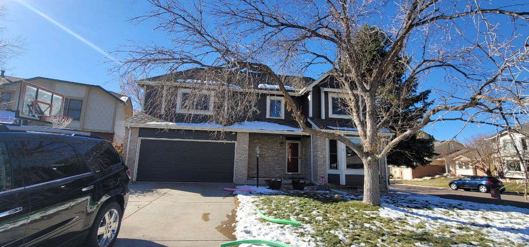Centennial, CO - We are doing a roof repair on this house in Aurora that has some roof flashing that needed some work