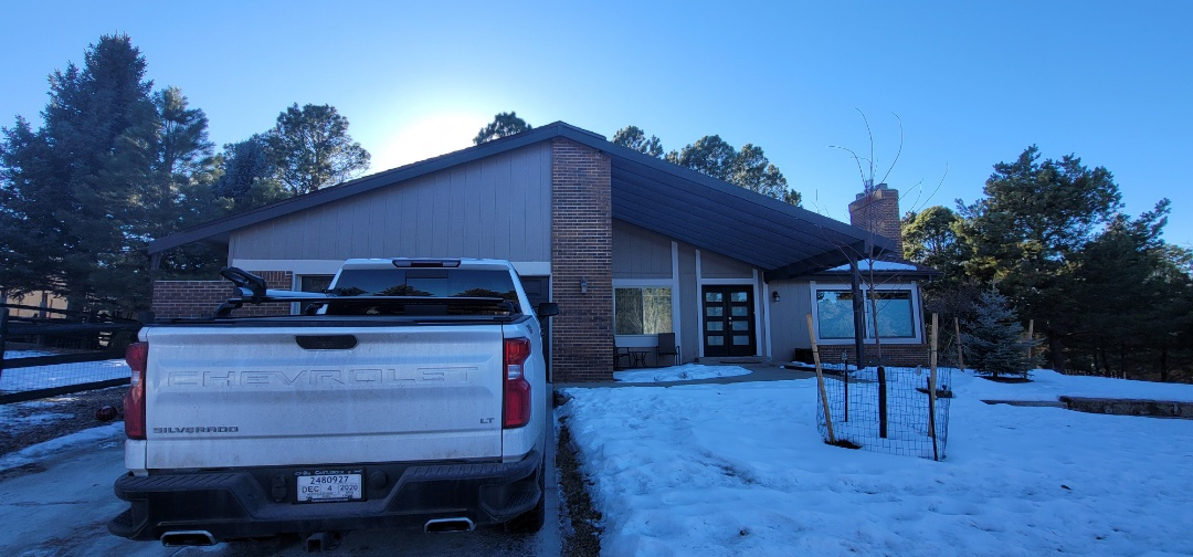 Parker, CO - We are doing a roof inspection for this house in Parker with a flat roof that has a roof leak