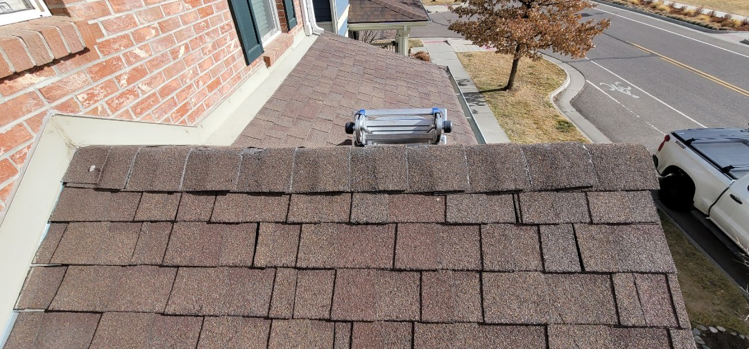 Denver, CO - We are doing a roof repair on this roof in Aurora that has a roof leak and clogged gutters. We also did a gutter replacement on one section of the garage because the owner never did a gutter cleaning so the gutter rotted out