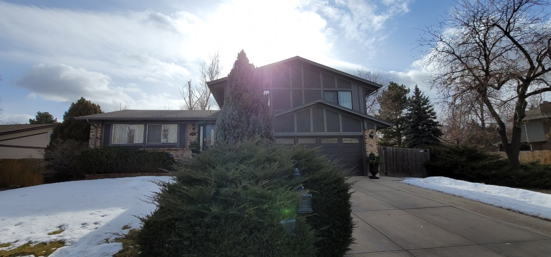 Aurora, CO - We are doing a roof inspection for a roof in Aurora that has hail damage and requires roof replacement and gutter replacement