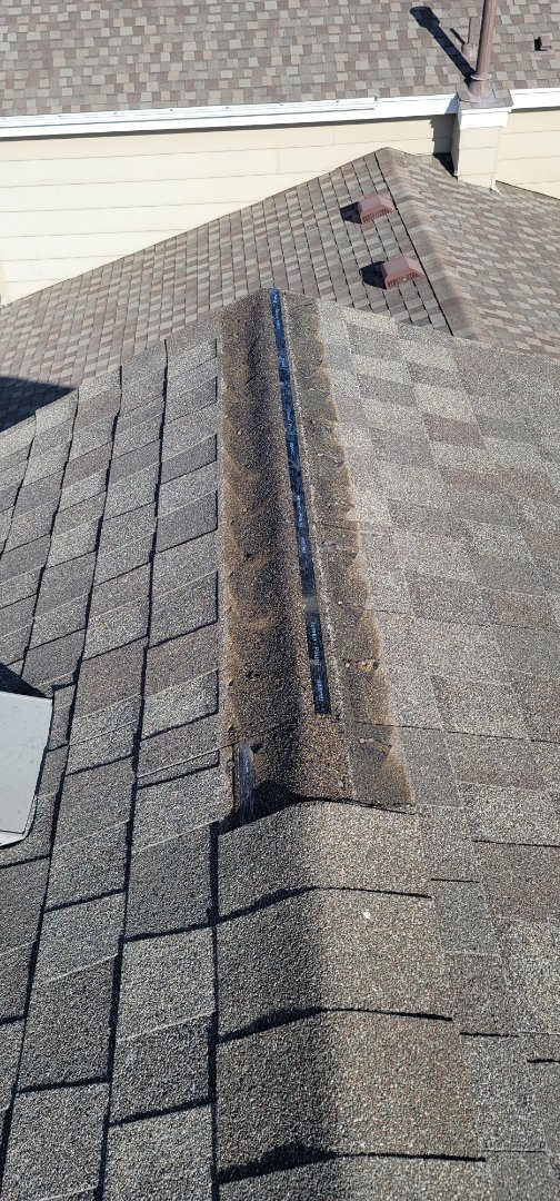 Parker, CO - We are doing a roof inspection for this house in Parker that had some shingles blow off in the last wind storm. Multiple shingles sustained wind damage and need to be replaced
