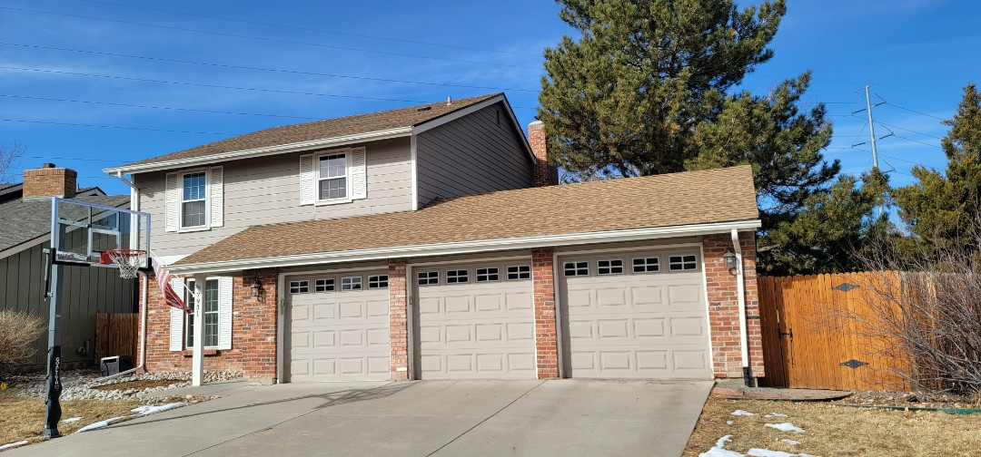Englewood, CO - We are doing a roof inspection for this house in Centennial that has some loose siding, loose flashing and loose siding