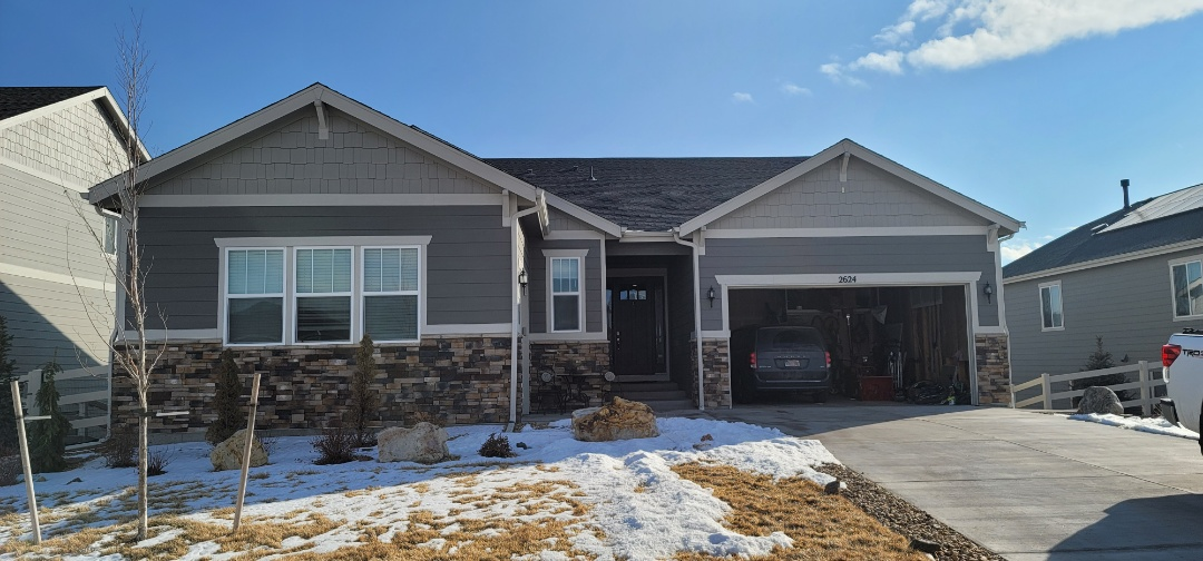 Castle Rock, CO - We are doing a roof inspection for this house in Castle Rock for new snow guards above the deck