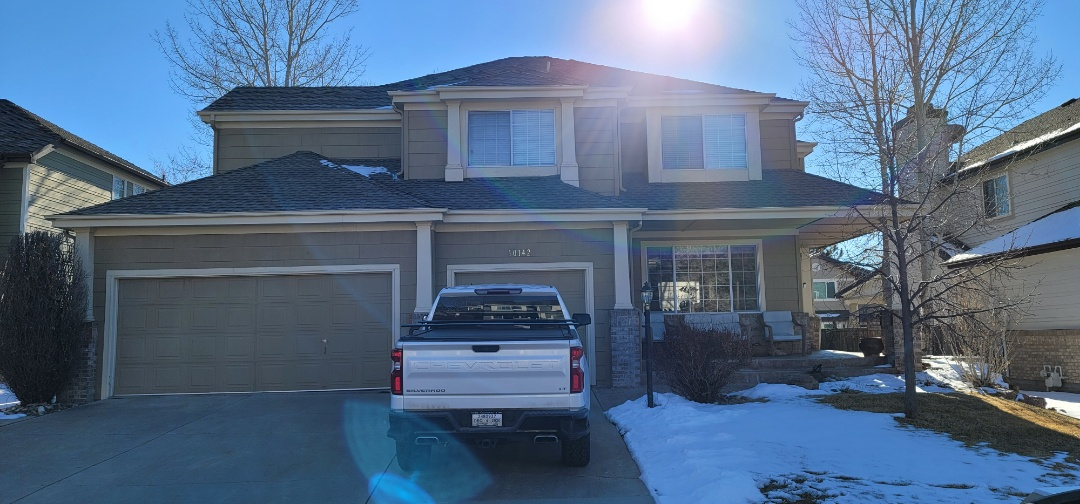 Parker, CO - We are doing a roof inspection for this house in Parker that has ice damaging issues which has resulted in a roof leak around her chimney