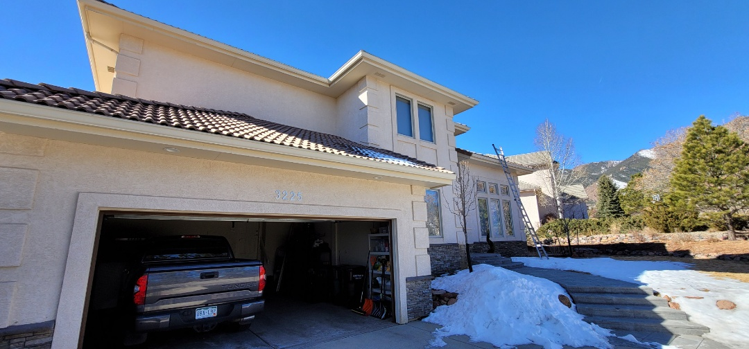 Colorado Springs, CO - We are doing a roof repair and a gutter ceiling and gutter repair for this house in Colorado Springs that has leaking onto the front porch causing an ice slick when it snows
