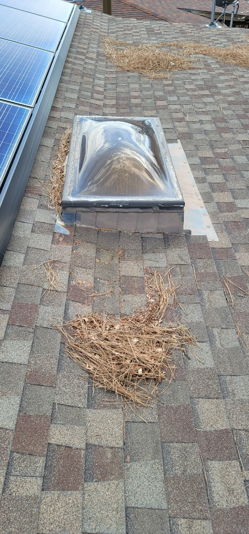 Denver, CO - We are doing a roof inspection for this house in Denver that has an old roof and a leak around a skylight