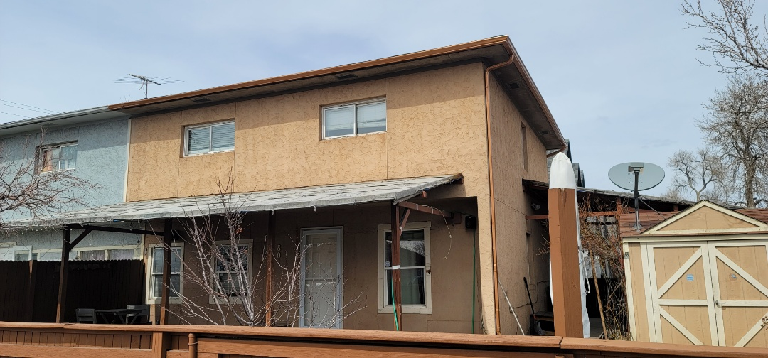 Denver, CO - we are doing a roof inspection for this house in Denver that needs a new carport and a new roof over a front porch as well as new gutters