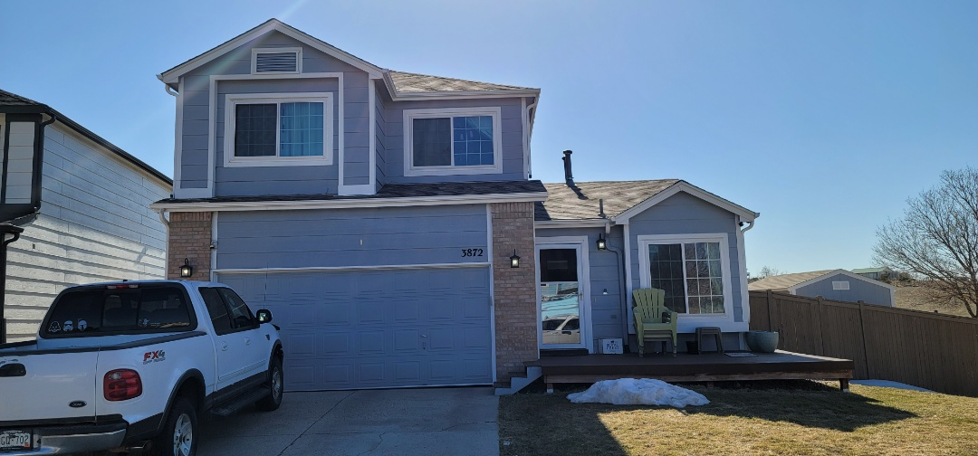 Castle Rock, CO - We are doing a roof inspection in Castle Rock for this house that has some lifted shingles because it backs to open space and has some bad winds