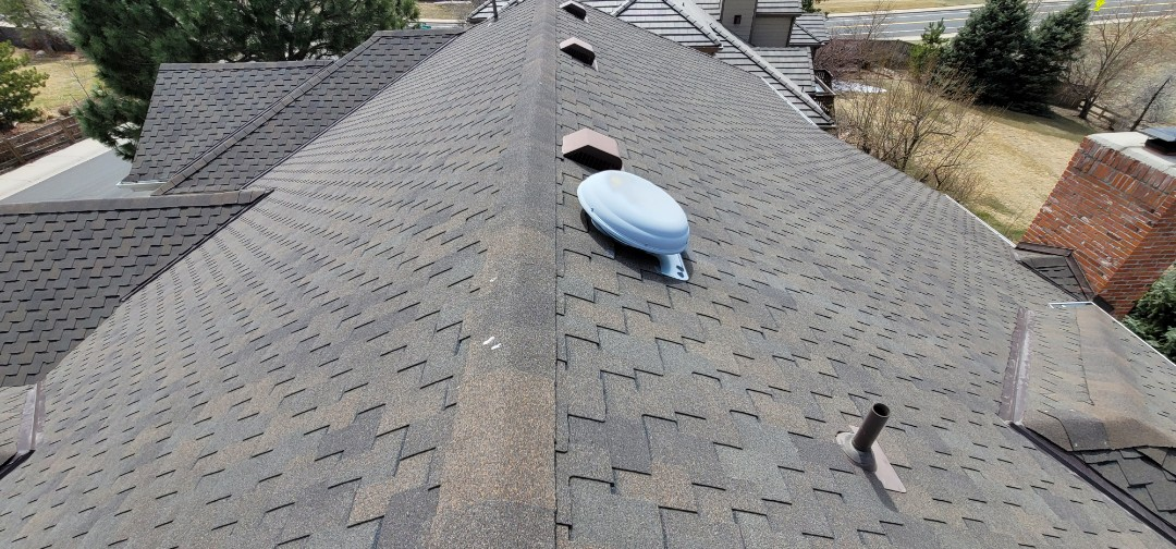 Littleton, CO - We are doing a roof inspection for this house in Highlands Ranch that has a leak coming to the wall due to a vent flashing that has failed