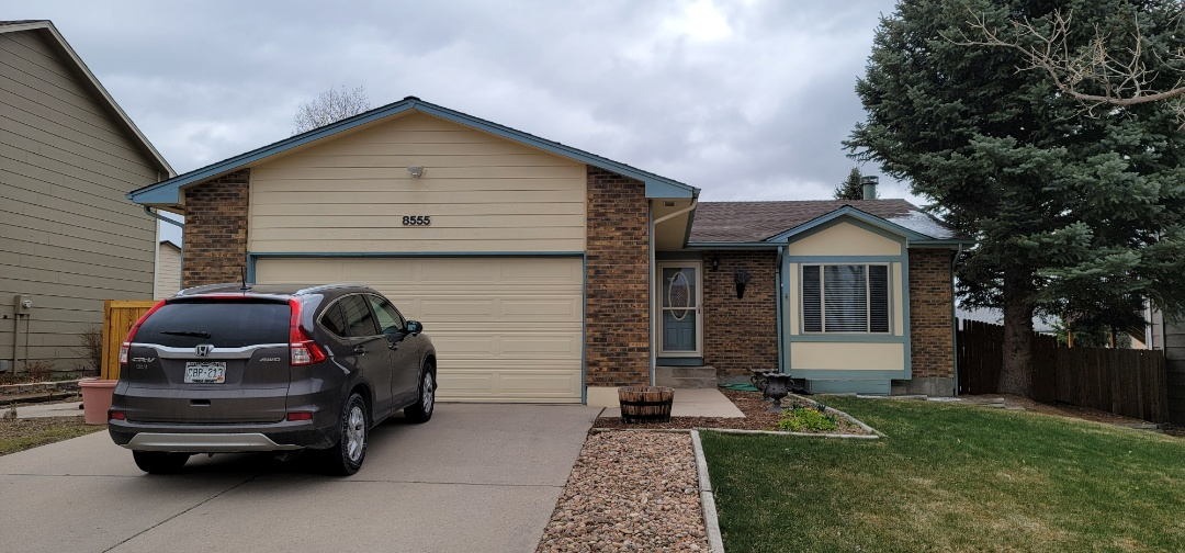 Colorado Springs, CO - We are doing a gutter replacement proposal for this house in Colorado Springs that has leaking above the front porch causing a problem with ice