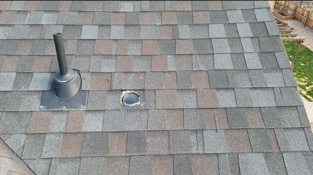 Castle Rock, CO - We are doing a roof inspection for this house in Castle Rock that has a roof leak due to the builders never installing a vent over a bathroom duct. We also discovered that the roof is failing prematurely and so we are going to plan on contacting the manufacturer of the shingles to see if we can do a full roof replacement