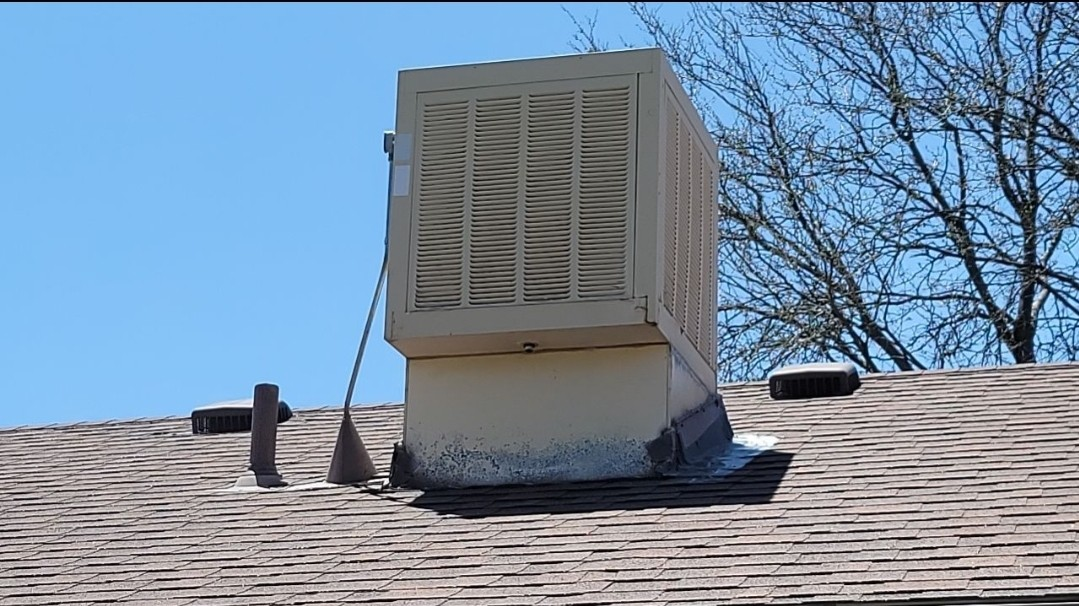 Littleton, CO - We are doing a roof inspection for this house in Littleton. We need to remove and dispose of this swamp cooler and do a roof patch where the swamp cooler is