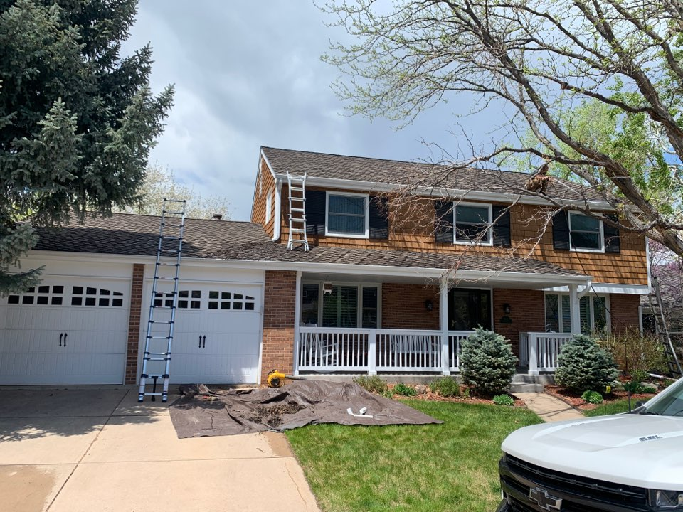Centennial, CO - Gutter cleaning. Cold water on a hot day is kind of refreshing.