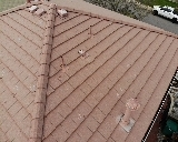 Littleton, CO - We are doing a roof inspection for this concrete tile roof that has broken tiles