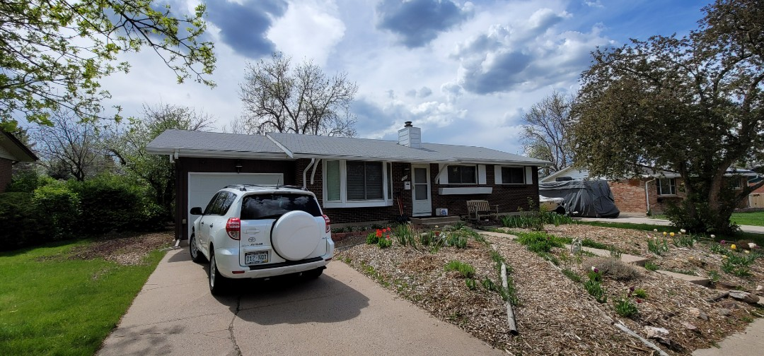 Centennial, CO - We are doing a gutter replacement for this house in Centennial that has PVC gutters right now and she wants to change to aluminum gutters and downspouts
