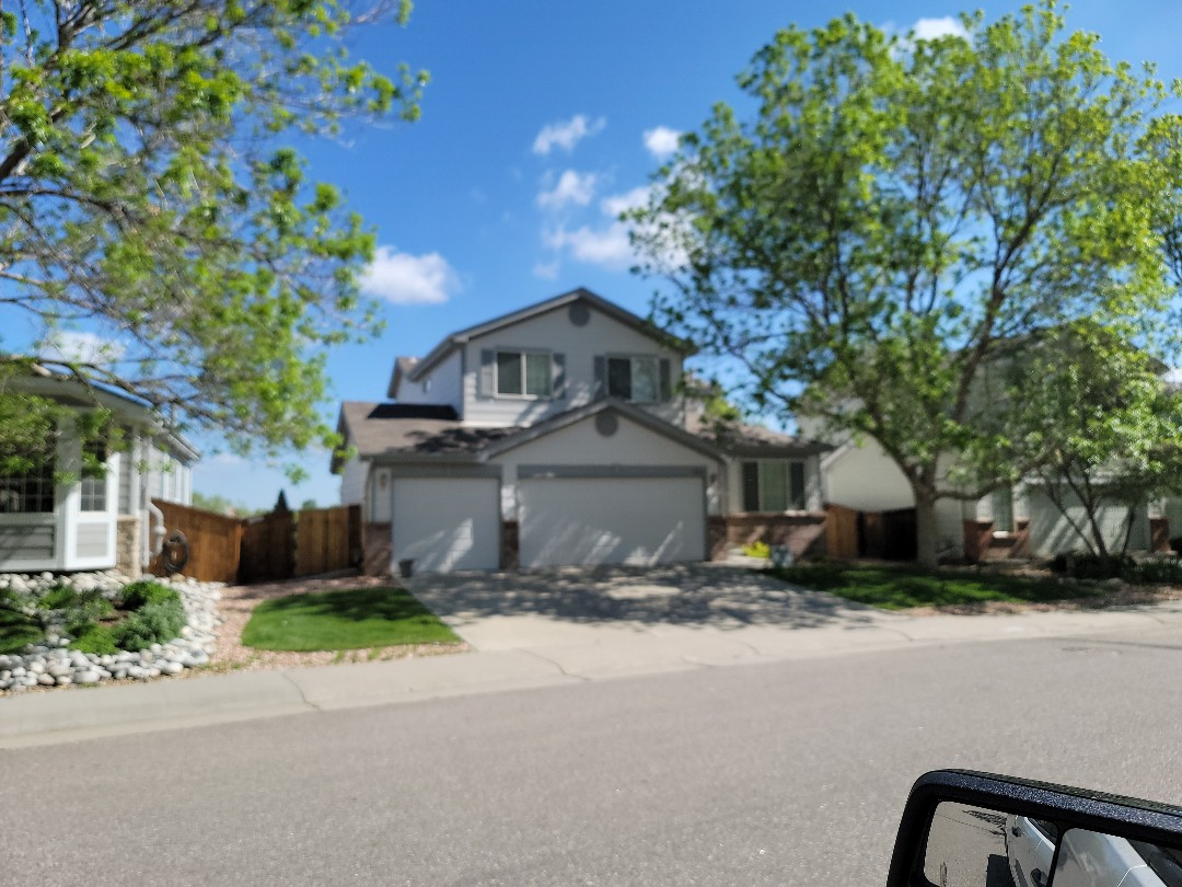 Lone Tree, CO - We are doing a roof repair for this house in Lone Tree that had some shingles missing due to a tree branch rubbing up against the roof