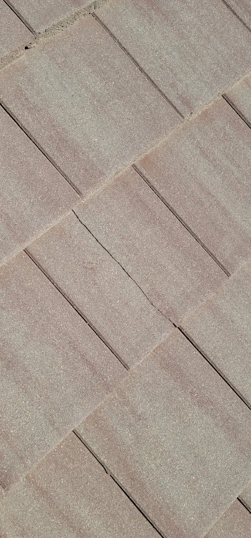 Centennial, CO - We are doing a roof inspection for this house in Aurora that has a roof leak that is causing his flooring to buckle
