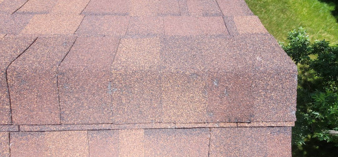 Aurora, CO - We are doing a roof inspection for this house in Aurora that will be on the market soon. There was some hail damage to the ridge cap shingles that need to be replaced