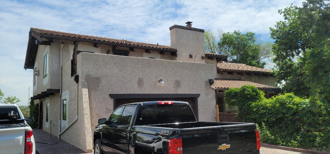 Centennial, CO - We are doing a roof inspection for this house in Aurora that needs a full roof replacement due to old tiles that were installed incorrectly and faulty underlayment causing leaking all over the house