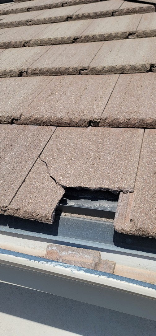 Lone Tree, CO - We are doing a roof inspection for this concrete tile roof in Lone tree that has a number of broken tiles. The house will be up for sale soon so the roof repair needs to happen before summer ends