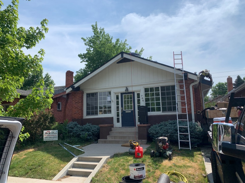 Denver, CO - New roof on house and garage, installing solar power attic fan on house and ridge vent on garage.