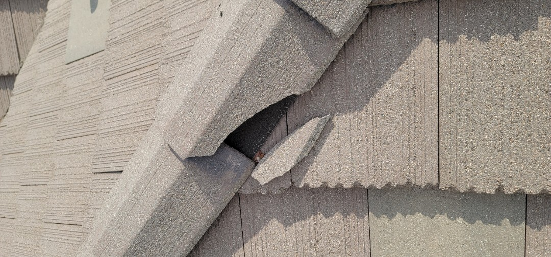 Parker, CO - We are doing a roof inspection for this concrete tile roof in Parker that has damage from golf balls.