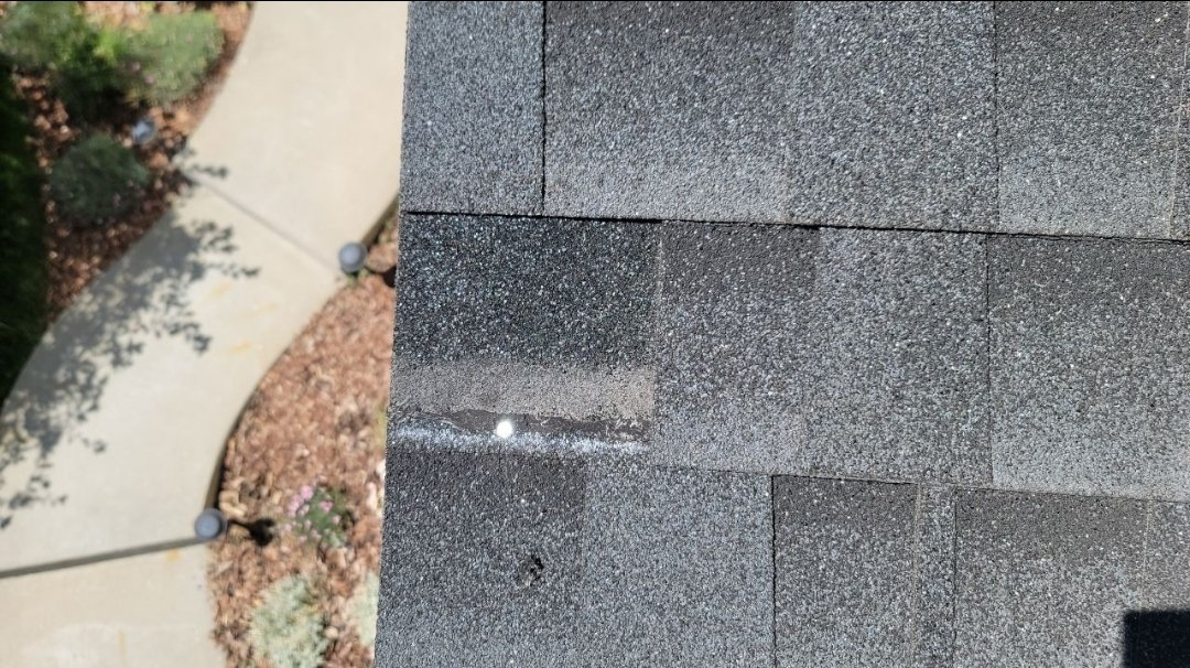 Highlands Ranch, CO - We are doing a roof inspection for this house in Highlands Ranch that has a roof leak through a roof vent. There's also some wind damage where a few shingles blew off that need to be replaced