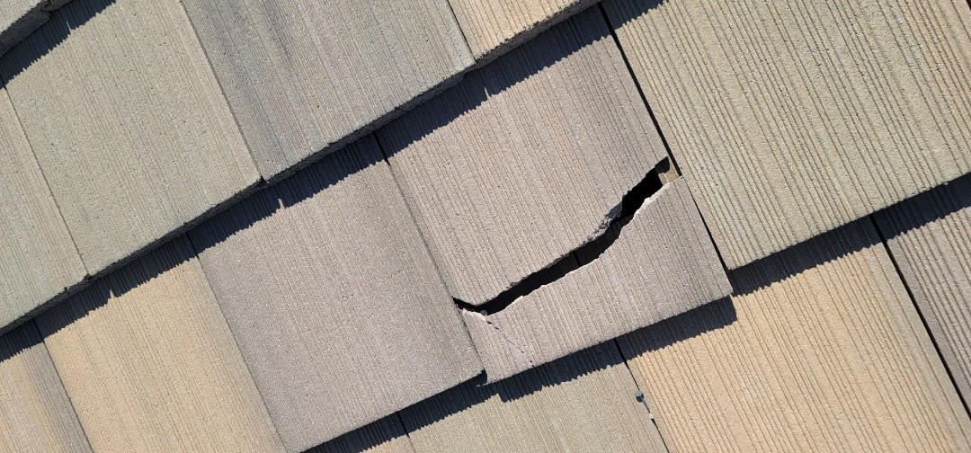 Parker, CO - We are doing a roof inspection for this concrete tile roof in Parker that has quite a few broken tiles that need to be replaced. The homeowner would also like us to do a gutter repair and some gutter installation where there has been no gutter before