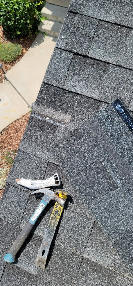 Littleton, CO - We are doing a roof repair for this house in Highlands Ranch that had some missing shingles blow off in the wind