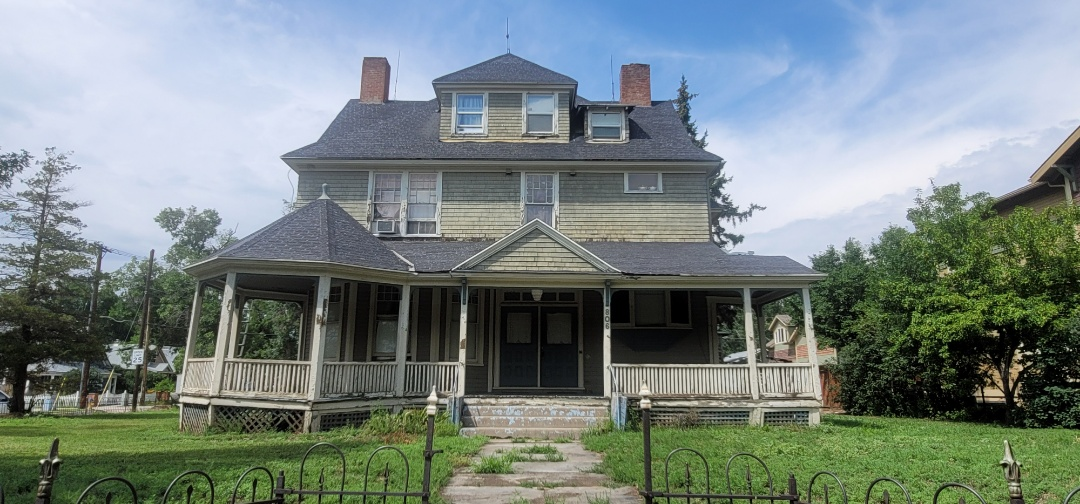 Colorado Springs, CO - We are bidding a full roof replacement for this Victorian house in Colorado Springs that needs a new roof, new gutters, new downspouts and a bunch of work done to the exterior of the building.