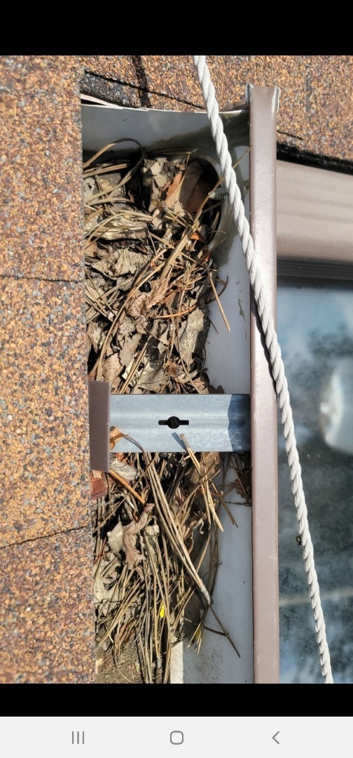 Aurora, CO - We are doing a roof inspection for a roof leak over a sunroom for this house in aurora. Turns out, the roof leak is because of gutters that are not sloped correctly. They are also filling up with debris so we are going to re-slope the gutters and install gutter screens
