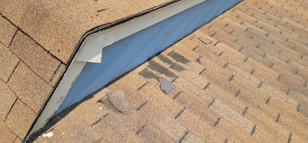 Littleton, CO - We are doing a roof inspection for this house in Littleton that has some shingles that were destroyed by a raccoon. We are also installing gutter screens and doing some fascia repair