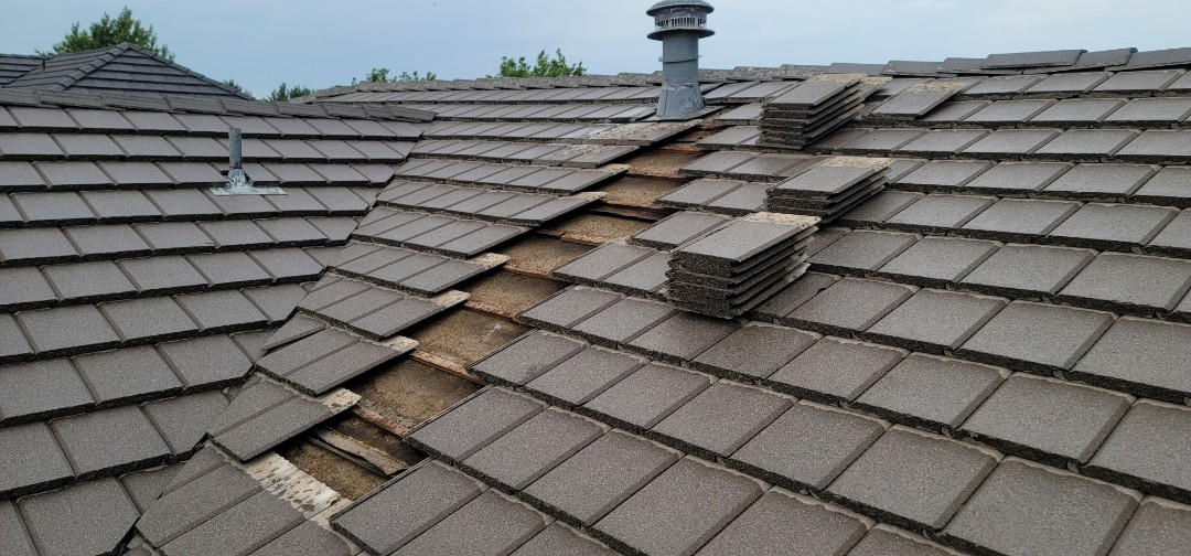 Littleton, CO - We are doing a roof inspection for a roof replacement for this house in Highlands Ranch that has a roof leak on this concrete tile roof