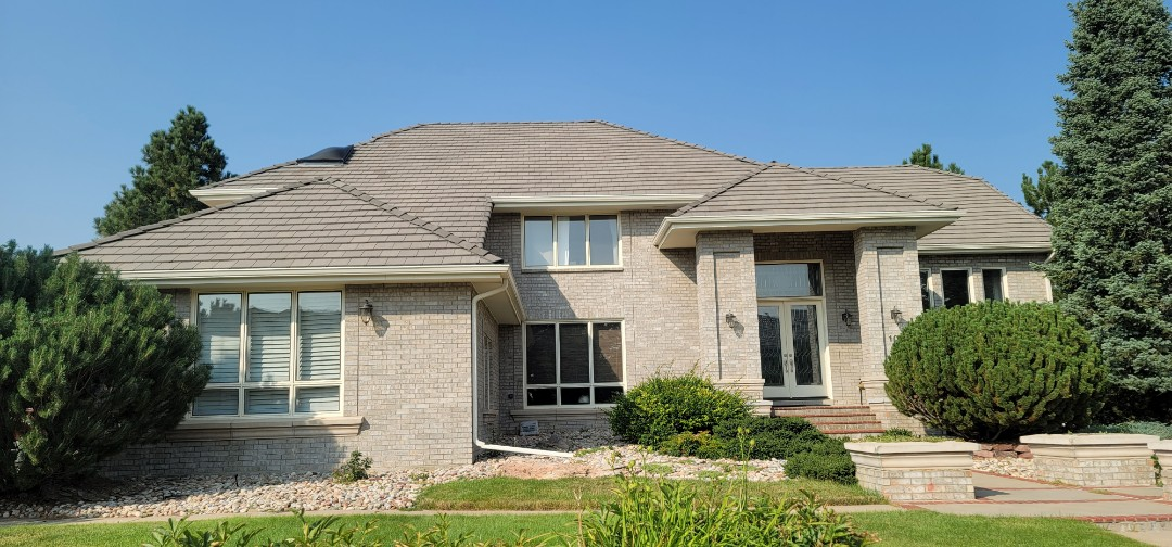 Littleton, CO - We are doing a gutter inspection for this house in Highlands Ranch that wants to install new gutters on a back deck that never had gutters and is causing issues with water draining onto the stucco and damaging it. We are also looking to do a flat roof repair on an EPDM roof