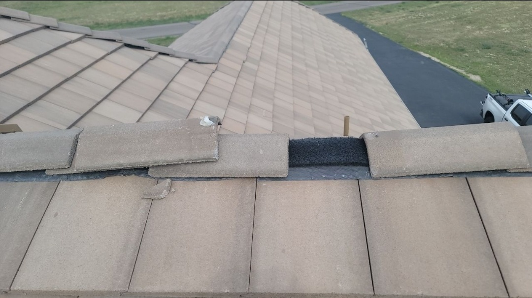 Elizabeth, CO - We are doing a roof inspection for this concrete tile roof in Elizabeth that has a number of broken roof tiles and some that has shifted that need to be reinstalled properly. The previous roofer did a poor job of a repair before the house was sold a year ago and we need to fix the mistakes