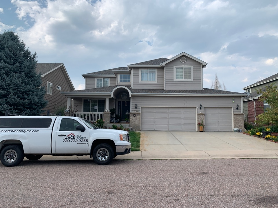 Parker, CO - New roof, new gutters, new window screens and a new front railing on the porch.