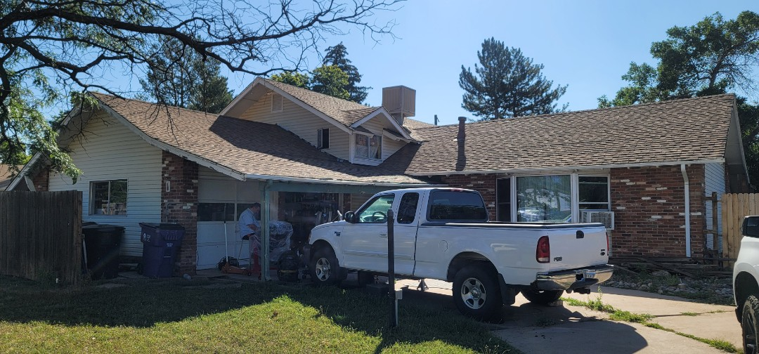 Denver, CO - We are doing a roof inspection for this house in Denver that needs a complete re-roof. The insurance company authorized a full roof replacement as well as new gutters and some house paint. We will work with his insurance company to get a few more items authorized for replacement