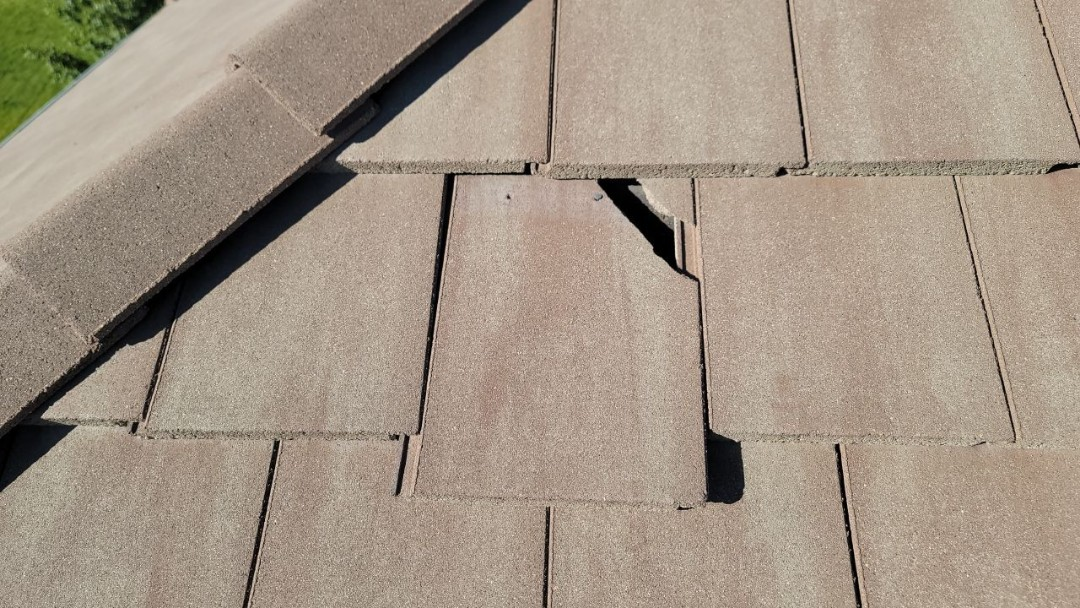 Littleton, CO - We are doing a roof inspection for this concrete tile roof in Highlands Ranch that has broken roof tiles that need to be replaced
