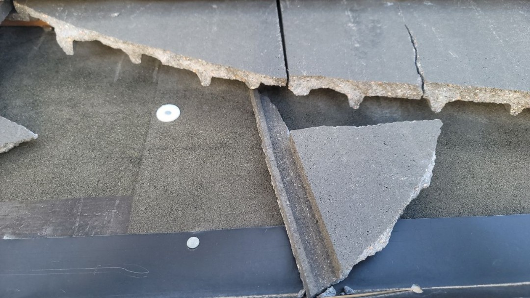 Littleton, CO - We are doing a roof repair for this concrete tile roof in Lone Tree